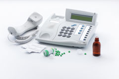 Telephone set and medicines in tablets or drops Royalty Free Stock Images