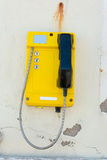 Telephone set mounted on a dilapidated wall Stock Photo