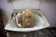 Telephone in sink Stock Image