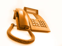 Telephone study 2. Ordinary office telephone with orange filter stock images