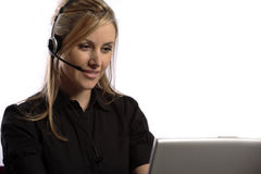 Telephone Support Operator. Blonde lady with deadset and laptop performing online help Royalty Free Stock Photos