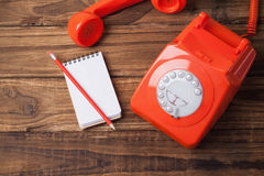 Telephone on table with notepad Stock Photos