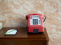 A telephone. A traditional telephone on a table Royalty Free Stock Photos