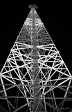 Telephone transmission tower. Low angle view of a tall telephone transmission tower at night royalty free stock photos