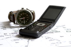 Telephone watch and map. On table royalty free stock photography