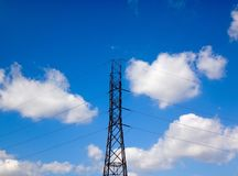 Telephone wires against a bright blue sky Stock Image