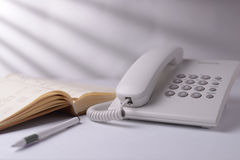 Telephone With Open Book Royalty Free Stock Photography