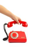 Telephone and woman hand Royalty Free Stock Photography
