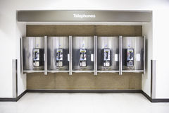 Telephones in an airport. Pay telephones in a line at an airport Stock Image