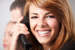 Telephoning. Young business women talking on the phone Stock Image