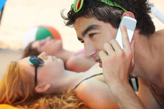 Telephoning from the beach Stock Photos