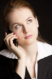 Telephoning businesswoman. Portrait of telephoning young businesswoman Royalty Free Stock Photos