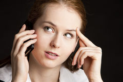 Telephoning businesswoman. Portrait of telephoning young businesswoman Stock Photography