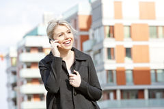 Telephoning businesswoman. Portrait of telephoning young businesswoman Royalty Free Stock Images