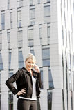 Telephoning businesswoman. Portrait of telephoning young businesswoman Royalty Free Stock Image