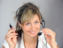 Telephonist. The operator woman in work Royalty Free Stock Photos