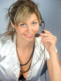Telephonist. The operator woman in work Stock Photography