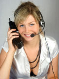 Telephonist. The young woman and phone Royalty Free Stock Image
