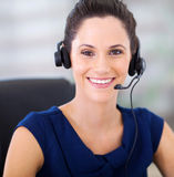 Telephonist with headphones. Pretty young telephonist with headphones closeup portrait Stock Photography