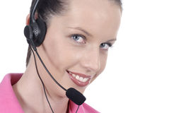 Young adult female woman telephonist, customer service, headset, smiling, looking at camera, white background Stock Image