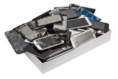 Telephons rotti nella scatola di cartone bianca Fotografia Stock