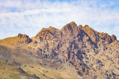 Telephoto detailed view of rocky mountain peak and jagged ridge. Royalty Free Stock Photo