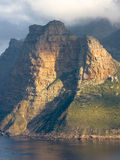 Telephoto: Hout Bay`s Sentinel Rock in the Western Cape of South Africa Stock Images
