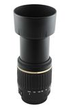 Telephoto lens. A fully extended telephoto lens with hood (isolated Royalty Free Stock Photo