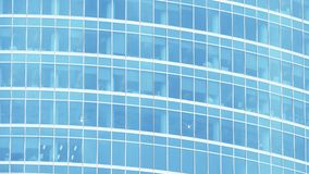 Telephoto shot of an office skyscraper, blue tint Royalty Free Stock Images