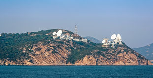 Teleport satellite communications. Group of teleport satellite communications antennas on cliffs near Hong Kong stock images