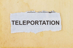 Teleportation. In a  newspaper cutout in an old paper background Royalty Free Stock Photos