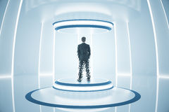 Teleporting businessman. Back view of businessman inside abstract teleportation sation. Future technologies concept. 3D Rendering stock images
