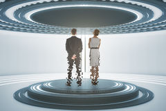 Teleporting businessman and woman. Back view of businessman and women inside abstract teleportation sation. Future technologies concept. 3D Rendering Stock Photo