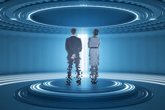 Teleporting businesspeople. Back view of businesspeople inside abstract teleportation sation. Future technologies concept. 3D Rendering stock photography