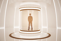 Teleporting man. Back view of man inside abstract teleportation sation. Future technologies concept. 3D Rendering Royalty Free Stock Photography