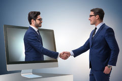 The telepresence concept with two businessman handshaking Royalty Free Stock Photo