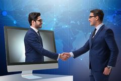 The telepresence concept with two businessman handshaking Stock Image