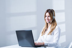 Telesales female consulatnt during work Royalty Free Stock Image