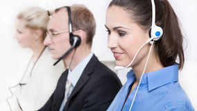 Telesales or helpdesk team with Headsets - workers at call Cente Stock Images
