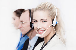 Telesales or helpdesk team - helpful woman with headset smling a stock photo