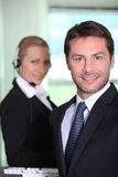 Telesales manager. Standing on front of colleague Stock Images