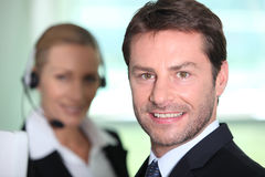 Telesales manager. Stood by a colleague Stock Photo