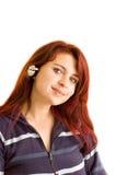 Telesales Operator. Pretty redhead wearing set of headphones stock photos
