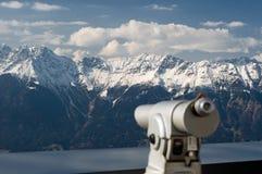 Telescope. Coin telescope on focus over mountain landscape Stock Photography