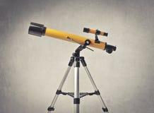 Telescope. Yellow professional astronomical telescope stock image