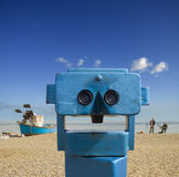 Telescope. The smiley face of a beach telescope with artists sketching fishing boat Royalty Free Stock Photos