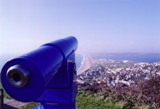 Telescope. Blue viewing telescope overlooking the bay Royalty Free Stock Images
