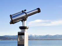 Telescope with alps Royalty Free Stock Images