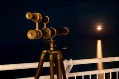 Telescope with amazing moonrising Stock Image