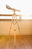 Telescope on the balcony and sunshine Royalty Free Stock Image